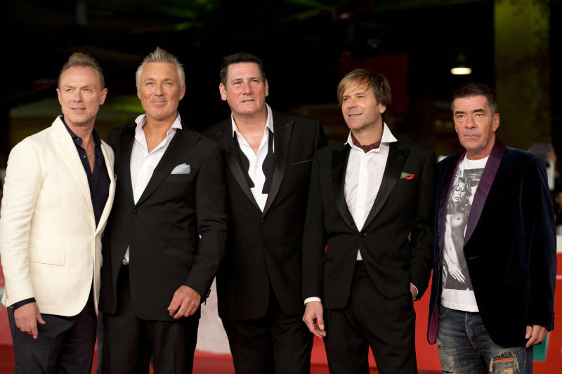 Members of the British band of Spandau Ballet, from left, Gary Kemp, Martin Kemp, Tony Hadley, Steve Norman and John Keeble arrive for the screening of the documentary 'Soul Boys of the Western World', in Rome, Monday, Oct. 20, 2014. (AP Photo/Andrew Medichini)