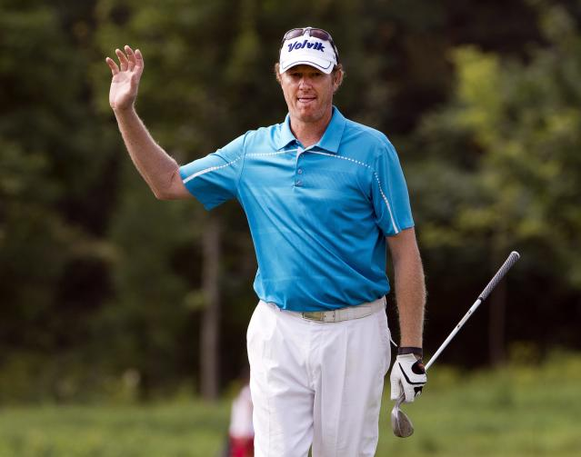Tim Petrovic reacts to his birdie chip in on the 15th hole during second round play at the Canadian Open golf championship Friday, July 25, 2014 in Montreal. (AP Photo/The Canadian Press, Ryan Remiorz)
