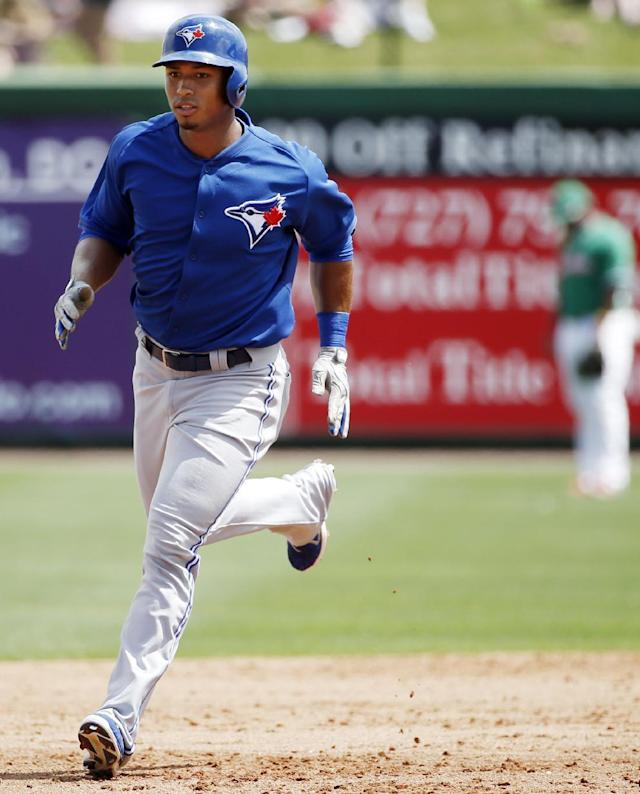 Toronto Blue Jays Moises Sierra runs the bases after hitting a second-inning, solo home run off Philadelphia Phillies starting pitcher David Buchanan in a spring exhibition baseball game in Clearwater, Fla., Thursday, March 20, 2014. The Jays won 3-1. (AP Photo/Kathy Willens)