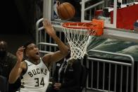 Milwaukee Bucks' Giannis Antetokounmpo shoots during the first half of an NBA basketball game against the Minnesota TimberwolvesTuesday, Feb. 23, 2021, in Milwaukee. (AP Photo/Morry Gash)