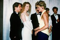 <p>The A-list couple met the Princess at the premiere of <em>Far and Away </em>in 1992. An up-and-coming Nicole Kidman wore a white sleeveless empire waist gown with elbow-length gloves. </p>
