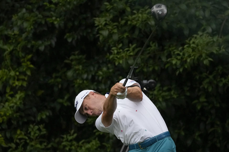 Justin Thomas tees off on the 14th hole during the first round of the Masters golf tournament on Thursday, April 8, 2021, in Augusta, Ga. (AP Photo/Charlie Riedel)