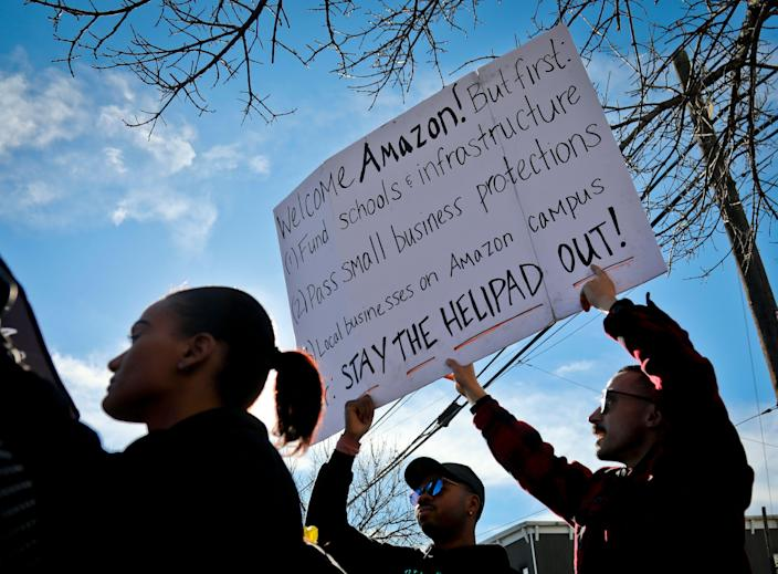 Protesters hold up anti-Amazon signs during a coalition rally and press conference in Long Island City, N.Y., Nov. 14, 2018. (Photo: Bebeto Matthews/AP)