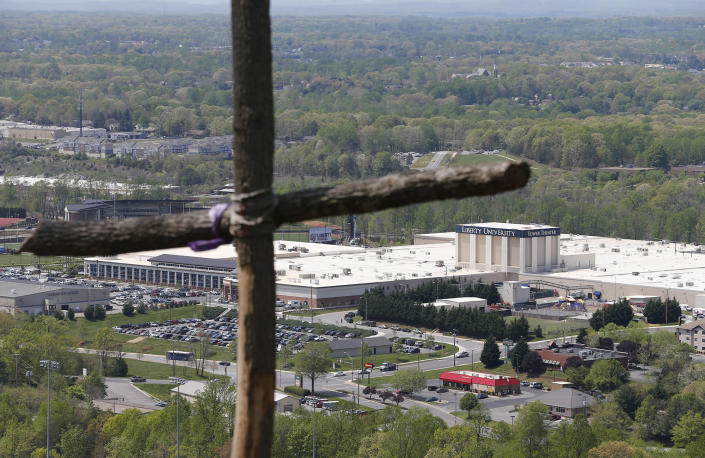 A cross erected on Candlers Mountain overlooks part of Liberty University in Lynchburg, Va., on April 21, 2015.