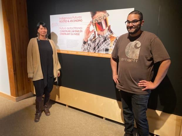 Melaw Nakehk'o and David Heslep at the Rooted and Ascending exhibit at the Prince of Wales Northern Heritage Centre. (Chantal Dubuc/CBC - image credit)
