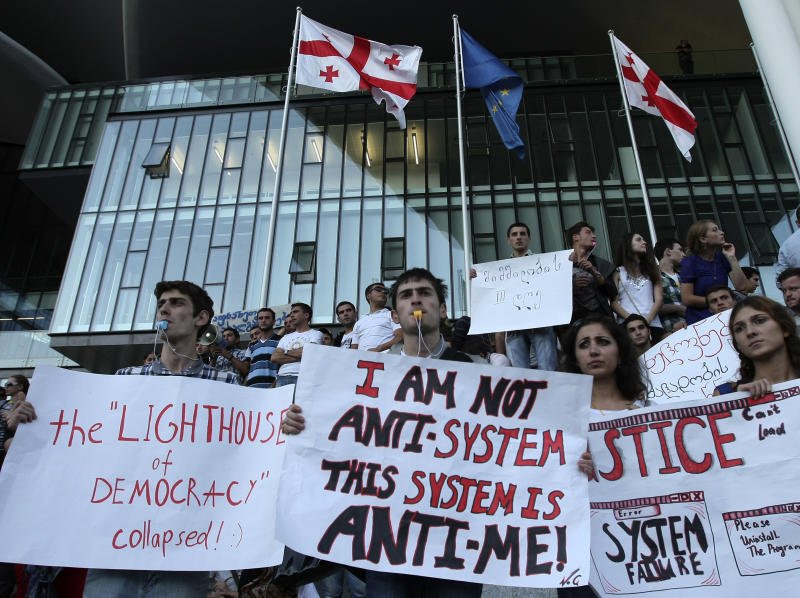 Demonstrators protest  against a prison abuse in Tbilisi, Georgia, Monday, Sept. 24, 2012. About 1,000 protesters have rallied in Tbilisi, Georgia, to demand the prosecution of a former minister fired in a prison abuse scandal. Monday's demonstration continued a series of rallies last week, which were sparked by graphic videos showing guards in the ex-Soviet nation brutally beating prisoners and raping them with truncheons and broom handles. (AP Photo/Shakh  Aivazov)