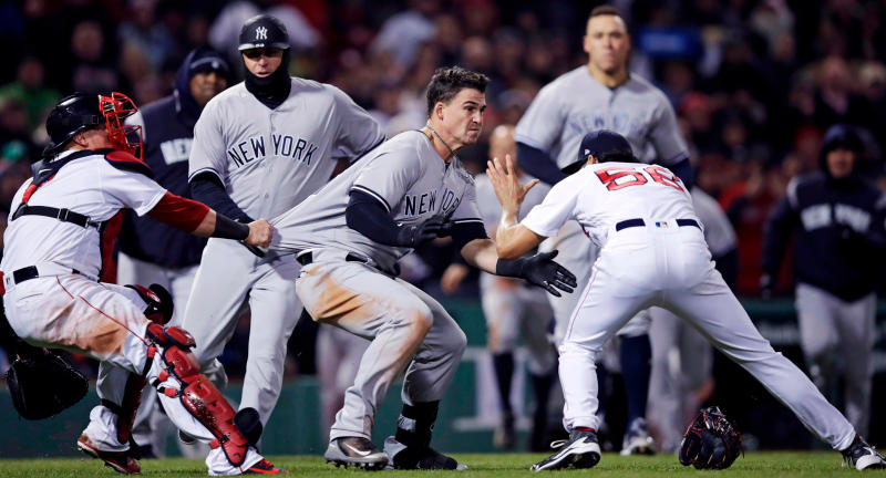 New York Yankees' Tyler Austin, center, rushes Boston Red Sox relief pitcher Joe Kelly, right, after being hit by a pitch during the seventh inning of a baseball game at Fenway Park in Boston. (AP Photo/Charles Krupa, File)