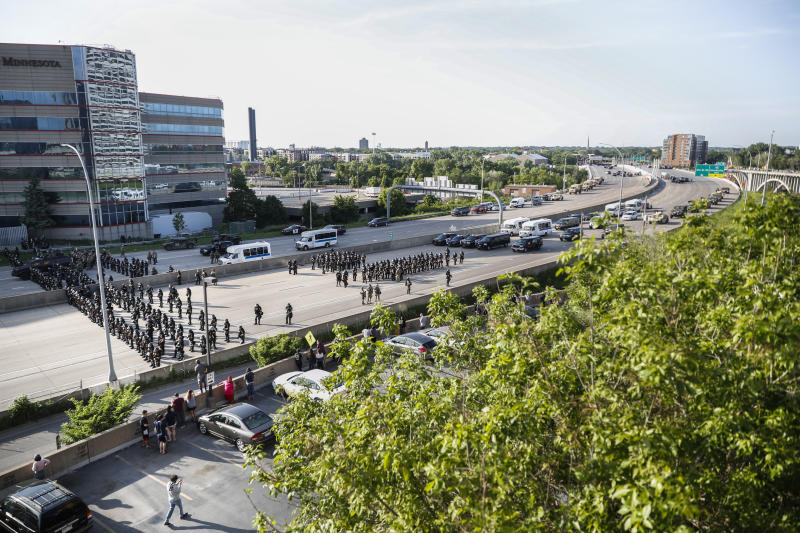 Highway 35W is closed by authorities after semi-truck was involved in an incident with protesters, Sunday, May 31, 2020, in St. Paul, Minn. Protests continued following the death of George Floyd, who died after being restrained by Minneapolis police officers on May 25. (AP Photo/John Minchillo)