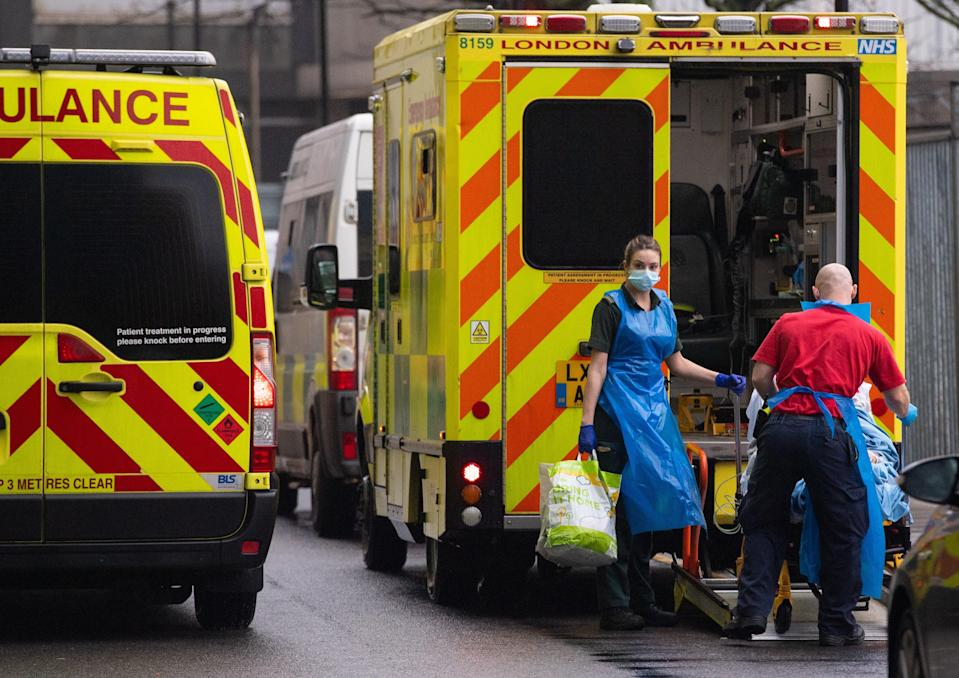 Paramedics unload a patient from an ambulance outside the Royal London Hospital during the peak of the second wave of coronavirus in January 2021 (Dominic Lipinski/PA) (PA Archive)