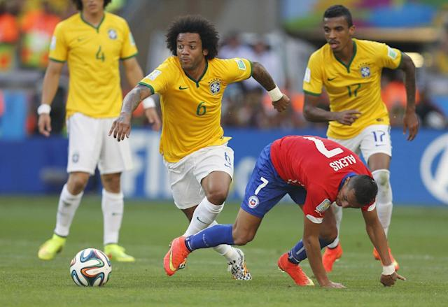 Brazil's Marcelo fights for the ball with Chile's Alexis Sanchez during the World Cup round of 16 soccer match between Brazil and Chile at the Mineirao Stadium in Belo Horizonte, Brazil, Saturday, June 28, 2014. (AP Photo/Frank Augstein)