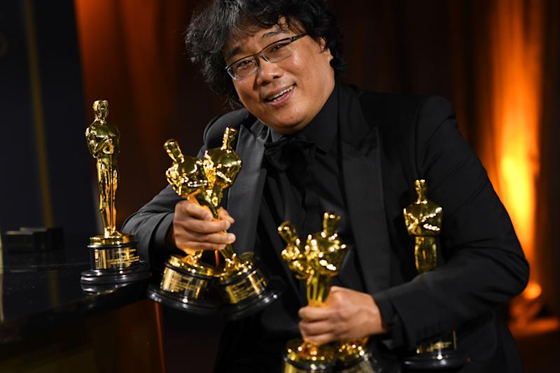 South Korean film director Bong Joon Ho poses with his engraved awards as he attends the 92nd Oscars Governors Ball. (Photo: VALERIE MACON via Getty Images)