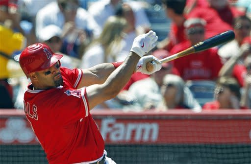 Los Angeles Angels' Albert Pujols hits a solo home run against the Chicago White Sox in the sixth inning of a baseball game in Anaheim, Calif., Thursday, May 17, 2012. (AP Photo/Reed Saxon)