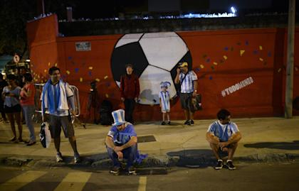 Dejected Argentina fans lament their team's loss to Germany in the World Cup final. (AP)