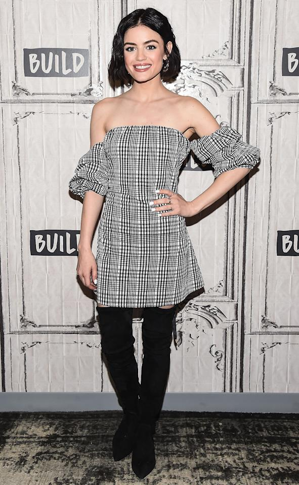 <p>wearing a black and white plaid off-the-shoulder mini dress with black over-the-knee Olgana Paris boots and Jenny Bird earrings at AOL Build Series in N.Y.C.</p>