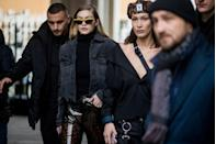 <p>In a denim jacket and very shiny pants while out in Milan with her sister, Bella Hadid.</p>