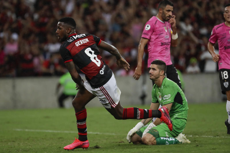 Gerson of Brazil's Flamengo celebrates scoring his side's second goal against Ecuador's Independiente del Valle during the final match of the Recopa at the Maracana stadium in Rio de Janeiro, Brazil, Wednesday, Feb. 26, 2020. (AP Photo/Leo Correa)