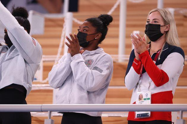 Simone Biles and MyKayla Skinner cheered on Sunisa Lee in the women's all-around. (Photo: Abbie Parr via Getty Images)