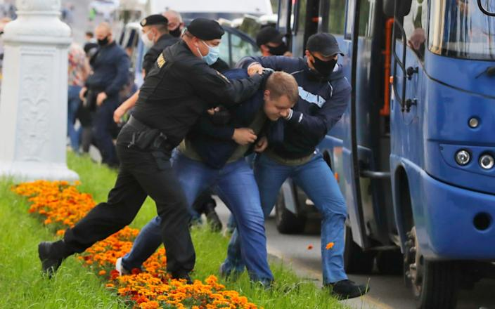 Anti-government protesters were detained in Minsk by police and plainclothes officers - Sergei Grits/AP