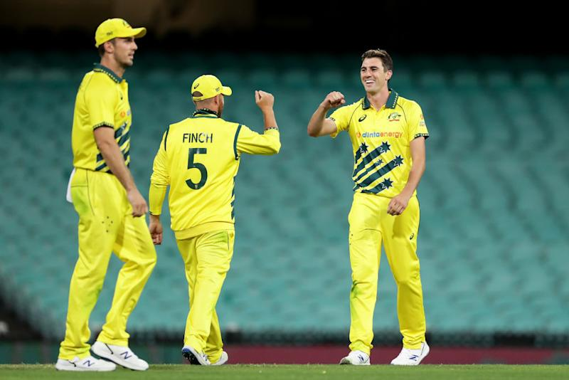 Pat Cummins of Australia celebrates with team mates after taking the final wicket of Trent Boult of New Zealand during game one of the One Day International series between Australia and New Zealand at Sydney Cricket Ground on March 13, 2020 in Sydney, Australia.