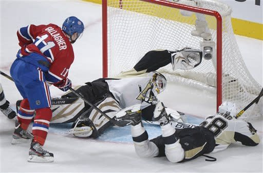 Pittsburgh Penguins goaltender Tomas Vokoun makes a save against Montreal Canadiens' Max Pacioretty as Canadiens' Brendan Gallagher and Penguins' Kris Letang look for the rebound during the first period of an NHL hockey game Saturday, March 2, 2013, in Montreal. (AP Photo/The Canadian Press, Graham Hughes)