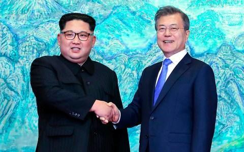 <span>North Korean leader Kim Jong-un, left, shanks with South Korean President Moon Jae-in at the Peace House at the border village of Panmunjom </span> <span>Credit: AP </span>