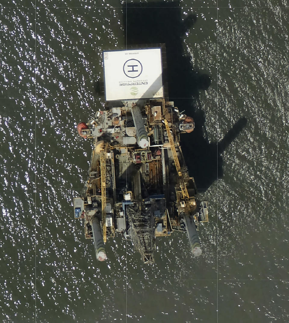 Photos captured by National Oceanic and Atmospheric Administration aircraft Tuesday, Aug. 31, 2021 and reviewed by The Associated Press a large rig marked with the name Enterprise Offshore Drilling is seen. The company, based in Houston, did not immediately respond to requests for comment by phone or email on Wednesday. EPA officials said Wednesday hey were unaware of any leak requiring a federal response. (NOAA via AP)