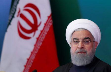 FILE PHOTO - Iranian President Hassan Rouhani attends a meeting with Muslim leaders and scholars in Hyderabad