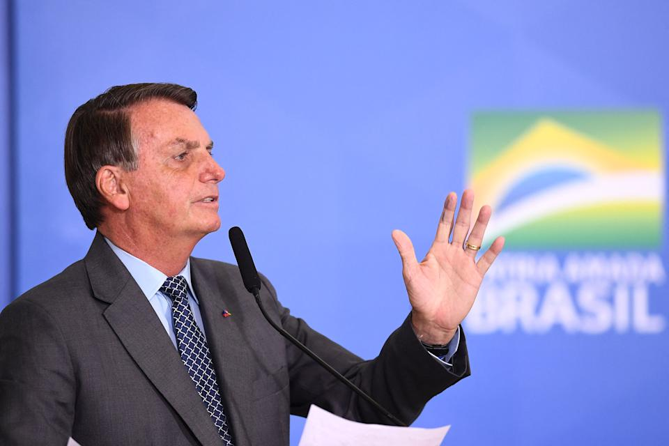 Brazilian President Jair Bolsonaro delivers a speech during the launch of the Gigantes do Asfalto Program, which aims to reduce bureaucracy for cargo trucking, at Planalto Palace in Brasilia, on May 18, 2021. (Photo by EVARISTO SA / AFP) (Photo by EVARISTO SA/AFP via Getty Images)