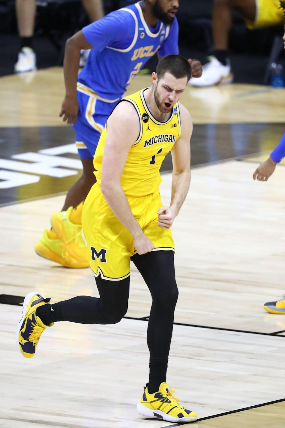 Michigan center Hunter Dickinson reacts during the first half of the Elite Eight game in the NCAA tournament on Tuesday, March 30, 2021, in Indianapolis.