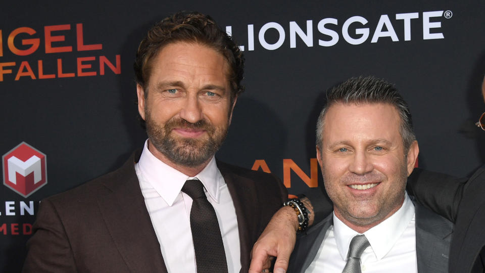 """Gerard Butler and Ric Roman Waugh attend the LA Premiere of """"Angel Has Fallen"""" on August 20, 2019. (Photo by Kevin Winter/Getty Images)"""