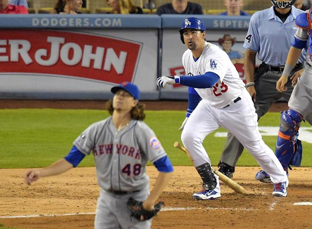 Los Angeles Dodgers' Adrian Gonzalez and New York Mets starting pitcher Jacob deGrom watch Gonzalez's three-run home run during the fifth inning of a baseball game, Saturday, Aug. 23, 2014, in Los Angeles. (AP Photo/Mark J. Terrill)