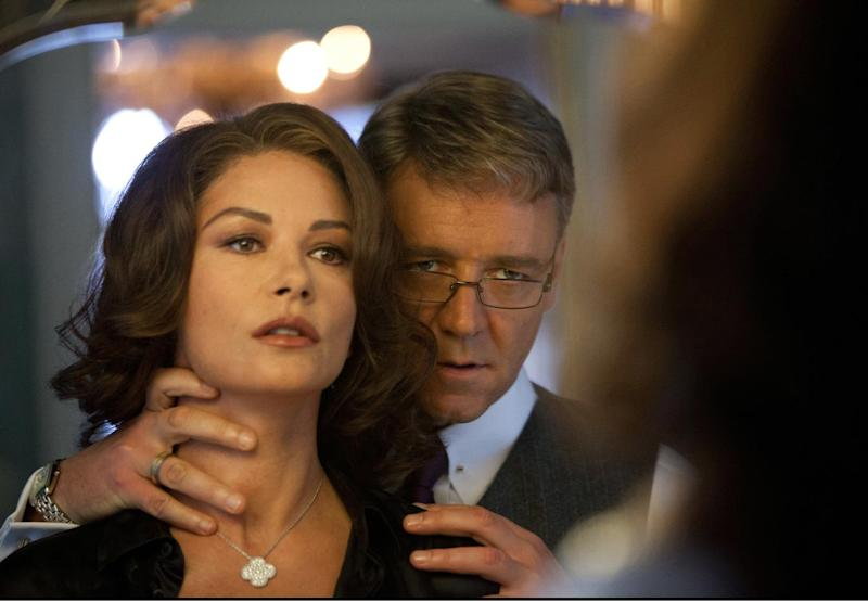 """This film image released by 20th Century Fox shows Catherine Zeta-Jones, left, and Russell Crowe in a scene from """"Broken City."""" (AP Photo/20th Century Fox, Alan Markfield)"""