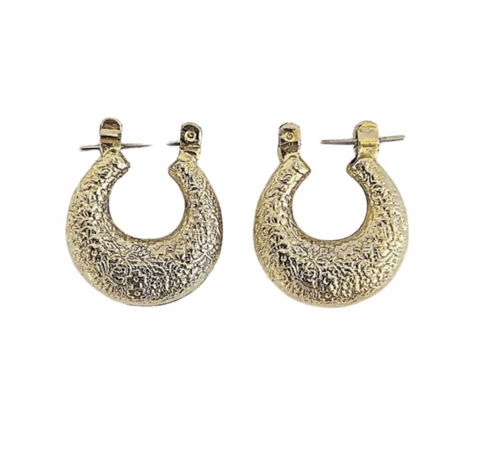 "<p><strong>Thrilling</strong></p><p>shopthrilling.com</p><p><strong>$75.00</strong></p><p><a href=""https://shopthrilling.com/collections/jewelry/products/80-s-gold-1-filigree-small-door-knocker-earrings"" rel=""nofollow noopener"" target=""_blank"" data-ylk=""slk:Shop Now"" class=""link rapid-noclick-resp"">Shop Now</a></p><p>Thrilling is a great online shopping destination for vintage finds. They stock affordable vintage accessories, shoes, and clothing. You can shop everything there from leather cowboy boots to flashy costume jewelry perfect for your next party.</p>"