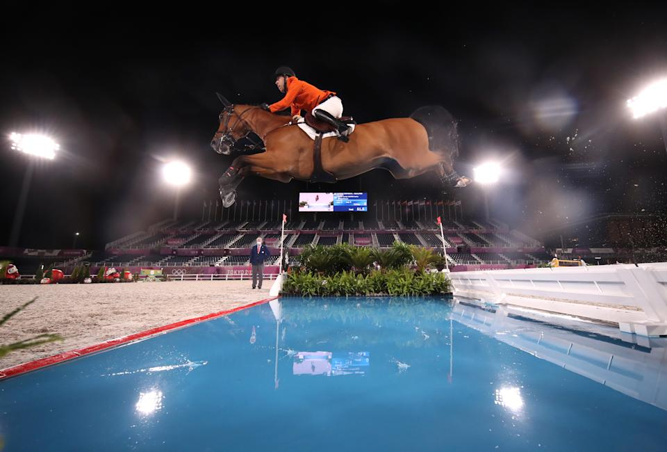 <p>TOKYO, JAPAN - AUGUST 03: Maikel van der Vleuten of Team Netherlands riding Beauville Z competes during the Jumping Individual Qualifier on day eleven of the Tokyo 2020 Olympic Games at Equestrian Park on August 03, 2021 in Tokyo, Japan. (Photo by Julian Finney/Getty Images)</p>
