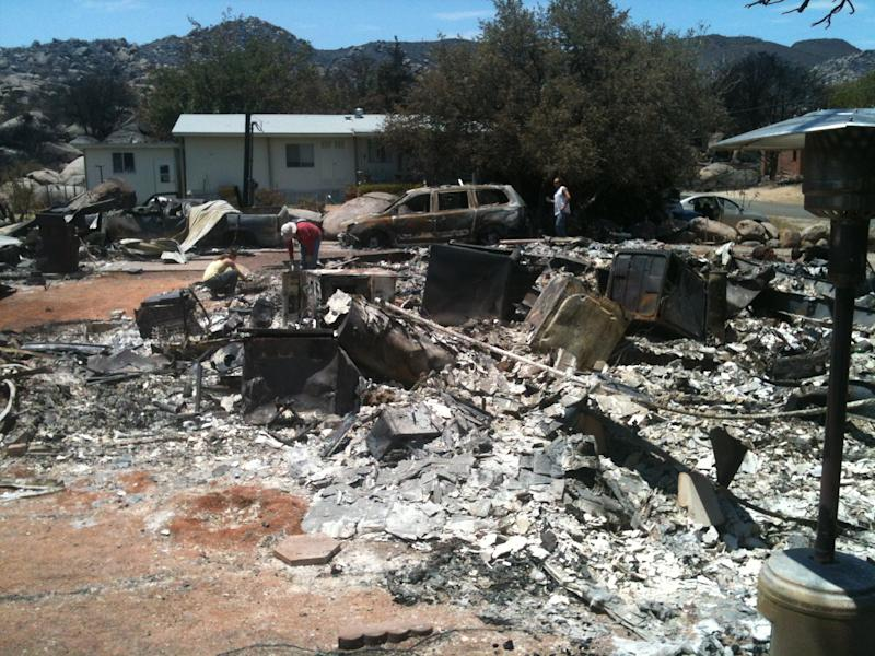 This July 8, 2013 photo provided by Bethany Hansom shows the fire-destroyed home of Larry and Patti McCracken, in Yarnell, Ariz. The married couple of nearly 50 years now have Patti's wedding ring back, found by one of their daughters underneath a foot of the charred rubble that used to be their dream retirement home in the small Arizona town of Yarnell, where an erratic wildfire killed 19 elite Hotshots firefighters and destroyed more than 100 homes on June 30. (AP Photo/Bethany Hansom)