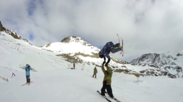 Skier performs the ultimate high five- video