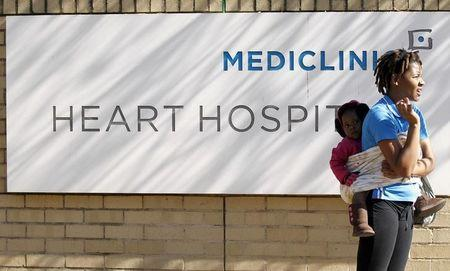 A woman and a child look on outside a hospital   in Pretoria, file.     REUTERS/Siphiwe Sibeko