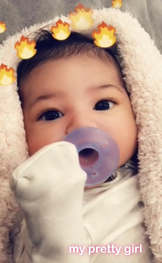 "<p>A week earlier, Kylie taught the tot about filters — which is sort of an essential lesson if you are born into the KarJenner family. The March 3 Snapchat video featured the big-eyed beauty sucking on a purple pacifier, with the social network's fire filter. ""My pretty girl,"" Kylie wrote. (Photo: Kylie Jenner via Snapchat) </p>"
