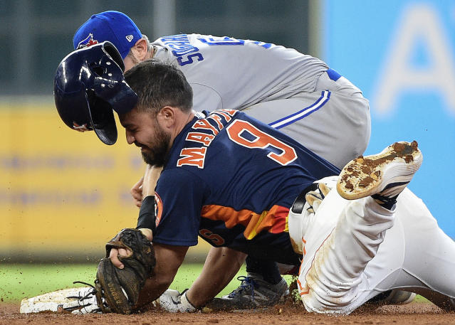 Houston Astros' Jack Mayfield (9) slides safely into second for a double, beating the tag of Toronto Blue Jays second baseman Eric Sogard during the sixth inning of a baseball game, Saturday, June 15, 2019, in Houston. (AP Photo/Eric Christian Smith)