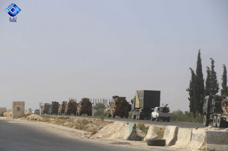 This photo provided by the activist-operated Thiqa News Agency, shows a Turkish military convoy heading toward the town of Khan Sheikhoun, in Idlib province, Syria, Monday, Aug. 19, 2019. The Turkish military convoy carrying ammunition crossed into northern Syria Monday and moved south through rebel-held areas before it was stopped by airstrikes that struck near the highway where the convoy was moving, opposition activists said. (Thiqa News Agency via AP)