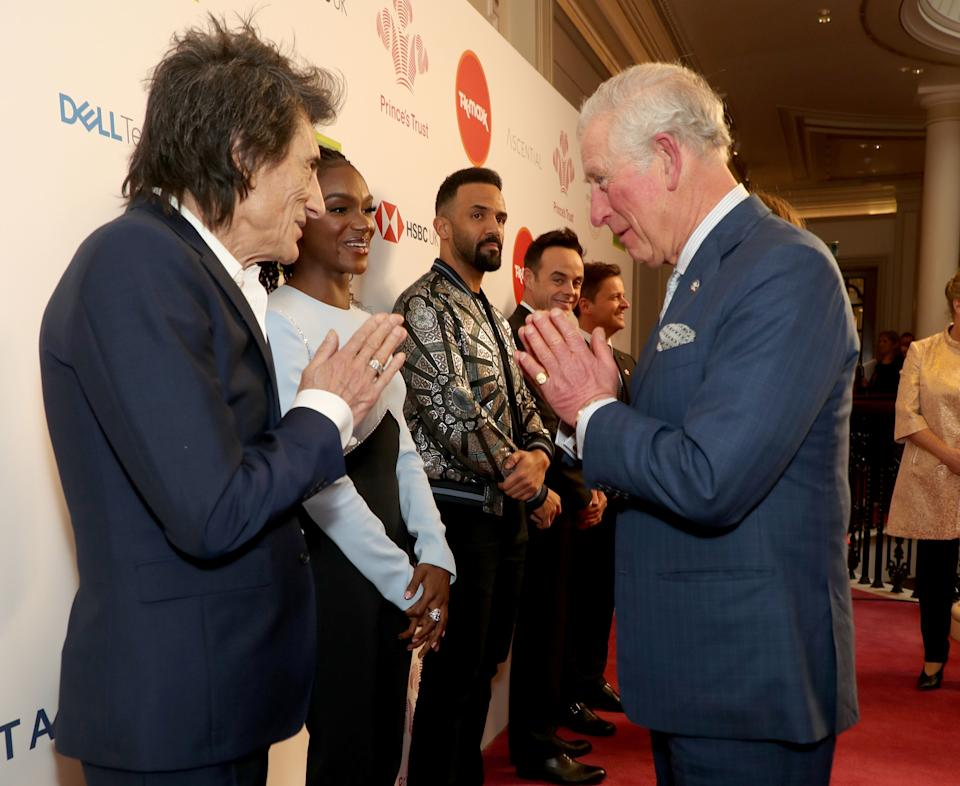 LONDON, ENGLAND - MARCH 11: Prince Charles, Prince of Wales uses a Namaste gesture to greet Rolling Stone Ronnie Wood as he attends the Prince's Trust And TK Maxx & Homesense Awards at London Palladium on March 11, 2020 in London, England. (Photo by Yui Mok - WPA Pool/Getty Images)