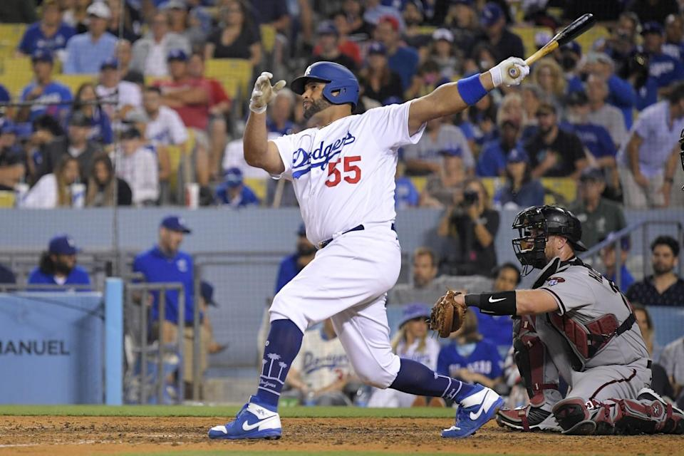 The Dodgers' Albert Pujols hits a solo home run during the seventh inning July 10, 2021.
