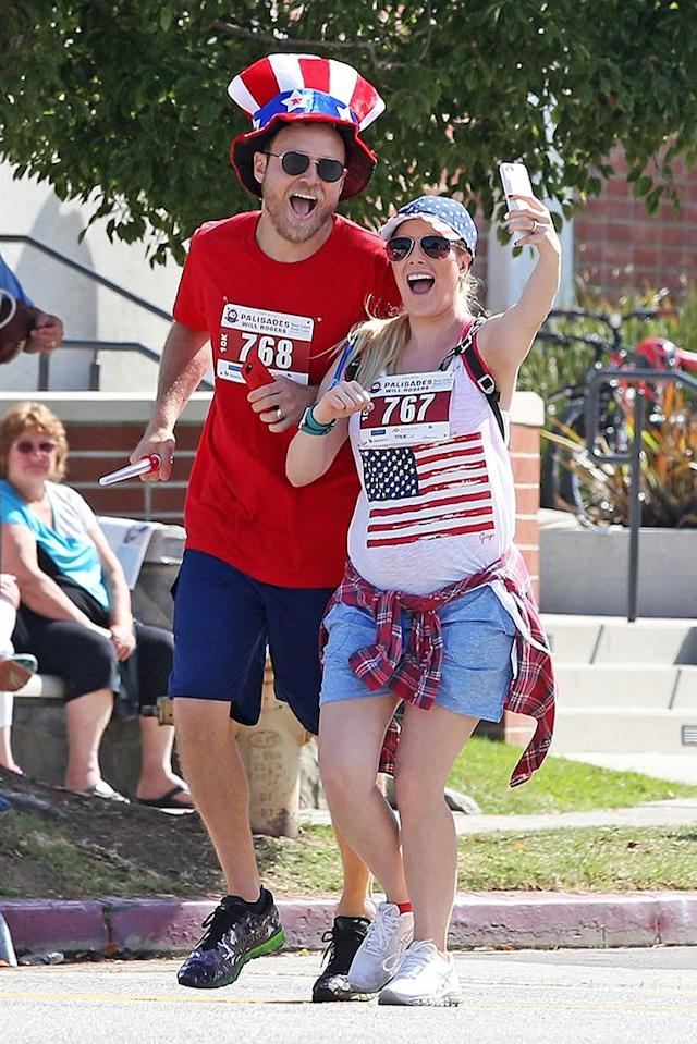 <p>The parents-to-be celebrated the Fourth of July by running an L.A. fun run. Of course, they took photos! (Photo: Mr Plow/BACKGRID) </p>