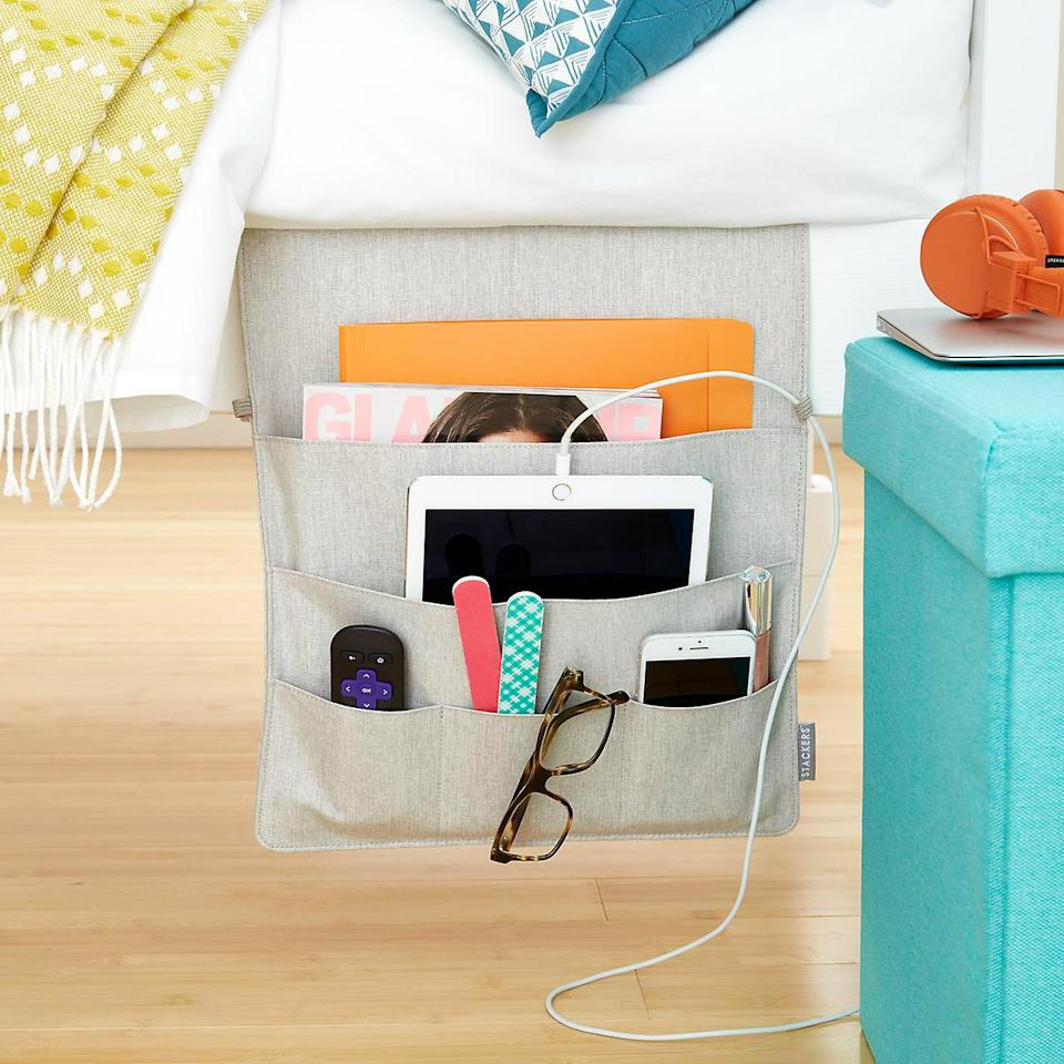 "<p>If your small space doesn't allow for a bedside table, keep essentials close with a bedside storage caddy. The linen caddy has a longer piece that slips underneath your mattress, allowing the five-pocket organizer to hang within reach. Cable loops let you charge your phone and small electronics while the larger pockets hold tablets, magazines, and textbooks for midnight cram sessions.</p> <p><strong><em>Shop Now:</em></strong><em> Stackers Bedside Storage Caddies, $29.99, <a href=""https://click.linksynergy.com/deeplink?id=93xLBvPhAeE&mid=37353&murl=https%3A%2F%2Fwww.containerstore.com%2Fs%2Fcollege%2Fbed-under-the-bed%2Fstackers-bedside-storage-caddies%2F12d%3FproductId%3D11002810&u1=MSL21DormRoomStorageIdeasThatMaketheMostofYourSmallSpacesbamseyStoGal7846410202007I"" rel=""nofollow noopener"" target=""_blank"" data-ylk=""slk:containerstore.com"" class=""link rapid-noclick-resp"">containerstore.com</a>.</em></p>"