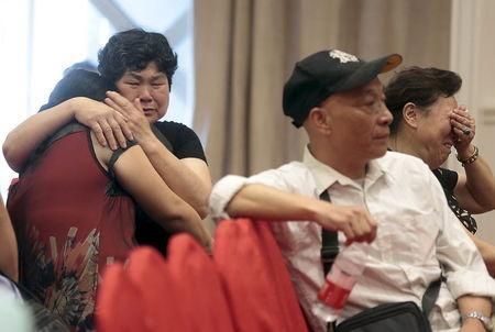 Relatives of passengers on the ship that sank at Jianli section of Yangtze River in Hubei province, cry as they wait for news at an arranged hotel, in Nanjing, Jiangsu province, China, June 2, 2015. REUTERS/Stringer