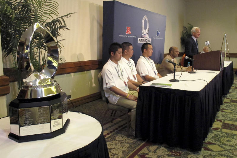 The Pro Bowl MVP stands in the foreground as Honolulu Mayor Kirk Caldwell speaks during a news conference to kick off NFL Pro Bowl week in Honolulu on Tuesday, Jan. 22, 2013. The NFL is hoping to decide the fate of the Pro Bowl by the time it releases next season's schedule in April. And the fate of the league's all-star game will largely depend on how much effort this year's participants put into the game. NFL Executive Vice President of Football Operations Ray Anderson told reporters of the timing at the news conference. He said the league expects its players to play a game that fans will be proud of. (AP Photo/Oskar Garcia)