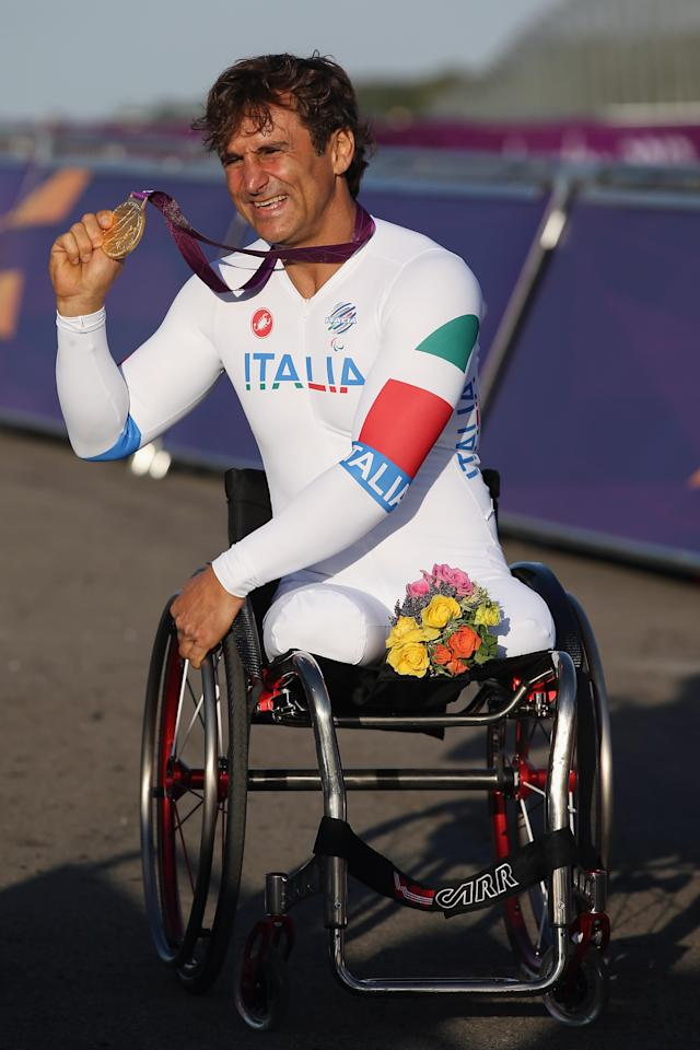 LONGFIELD, ENGLAND - SEPTEMBER 05: Alessandro Zanardi of Italy celebrates winning the Men's Individual H4 Time Trial on day 7 of the London 2012 Paralympic Games at Brands Hatch on September 5, 2012 in Longfield, England. (Photo by Hannah Johnston/Getty Images)