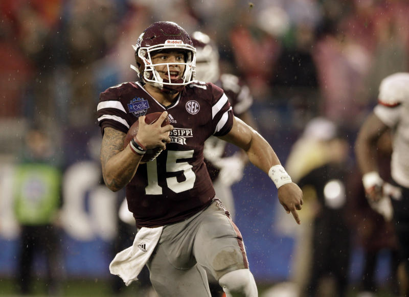 Mississippi State quarterback Dak Prescott (15) scrambles against North Carolina State in the first half of the Belk Bowl NCAA college football game in Charlotte, N.C., Wednesday, Dec. 30, 2015. (AP Photo/Nell Redmond)