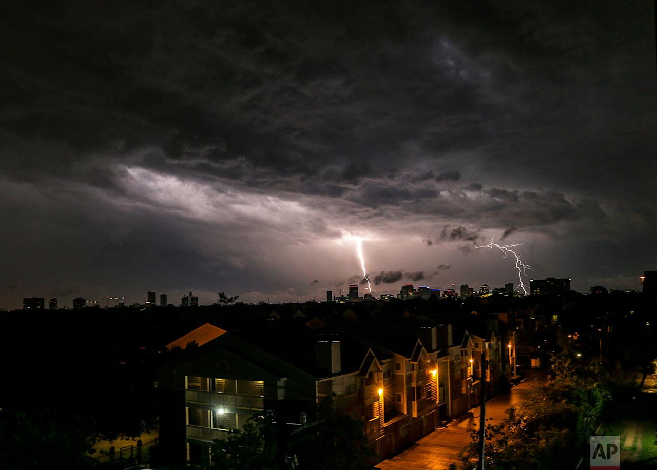 <p>Lightning strikes near the Medical Center in Houston. Strong winds that swept through the Houston area, caused damage including a hangar that collapsed at one of the city's airports, damaging planes and scattering debris. (Elizabeth Conley/Houston Chronicle via AP) </p>