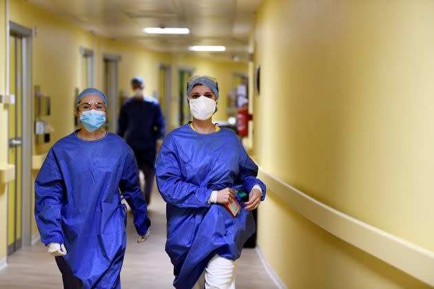 Members of the medical staff in protective suits walk along a corridor in the COVID-19 intensive care unit at the San Raffaele hospital in Milan, Italy, March 27, 2020. REUTERS/Flavio Lo Scalzo (Photo: Flavio Lo Scalzo via Reuters)